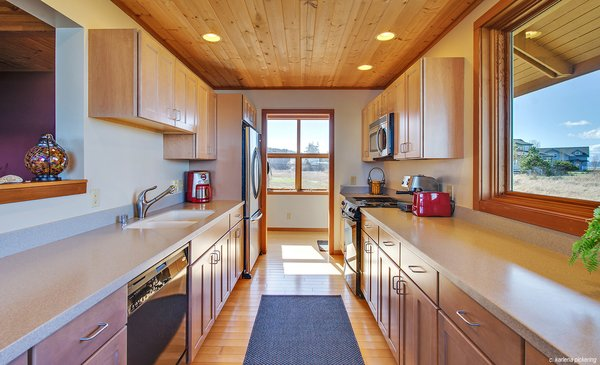 Galley Style Kitchen with Views and Lots of Counter Space Photo 9 of Idyllic Lopez Island Bayfront Home modern home