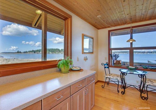 Corian Countertops and Breakfast Nook Photo 8 of Idyllic Lopez Island Bayfront Home modern home