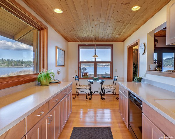 Large Windows Take in Bay Views in the Kitchen Photo 7 of Idyllic Lopez Island Bayfront Home modern home