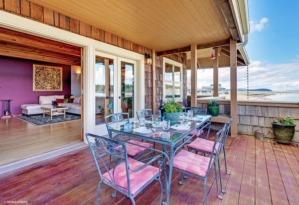 French Doors Open to Large Wrap Around Deck Photo 3 of Idyllic Lopez Island Bayfront Home modern home