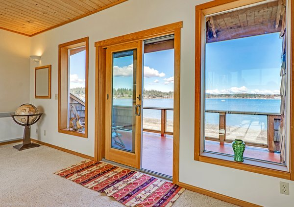 French Doors to 2nd Level Deck Overlooking Fisherman Bay Photo 14 of Idyllic Lopez Island Bayfront Home modern home