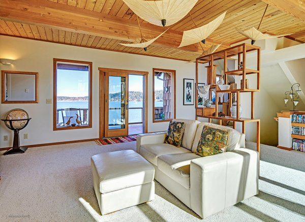 French Doors Leading to 2nd Floor Deck Overlooking the Bay Photo 12 of Idyllic Lopez Island Bayfront Home modern home