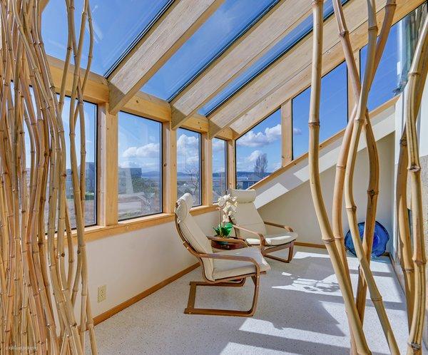 Atrium Sitting Area with Double Sided Propane Fireplace Photo 13 of Idyllic Lopez Island Bayfront Home modern home