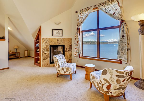 Third Floor Master Bedroom Sitting Area Photo 15 of Idyllic Lopez Island Bayfront Home modern home