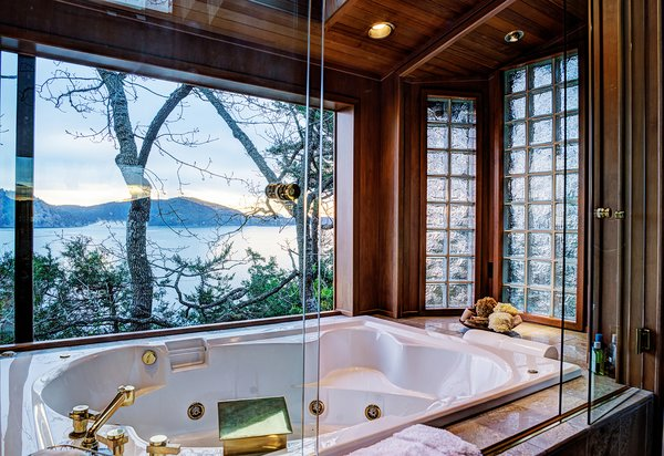 Custom Master Bath Features Jetted Tub & Large Sliding Window Photo 9 of Sea Oaks: Private Gated Compound on 4+ Acres modern home