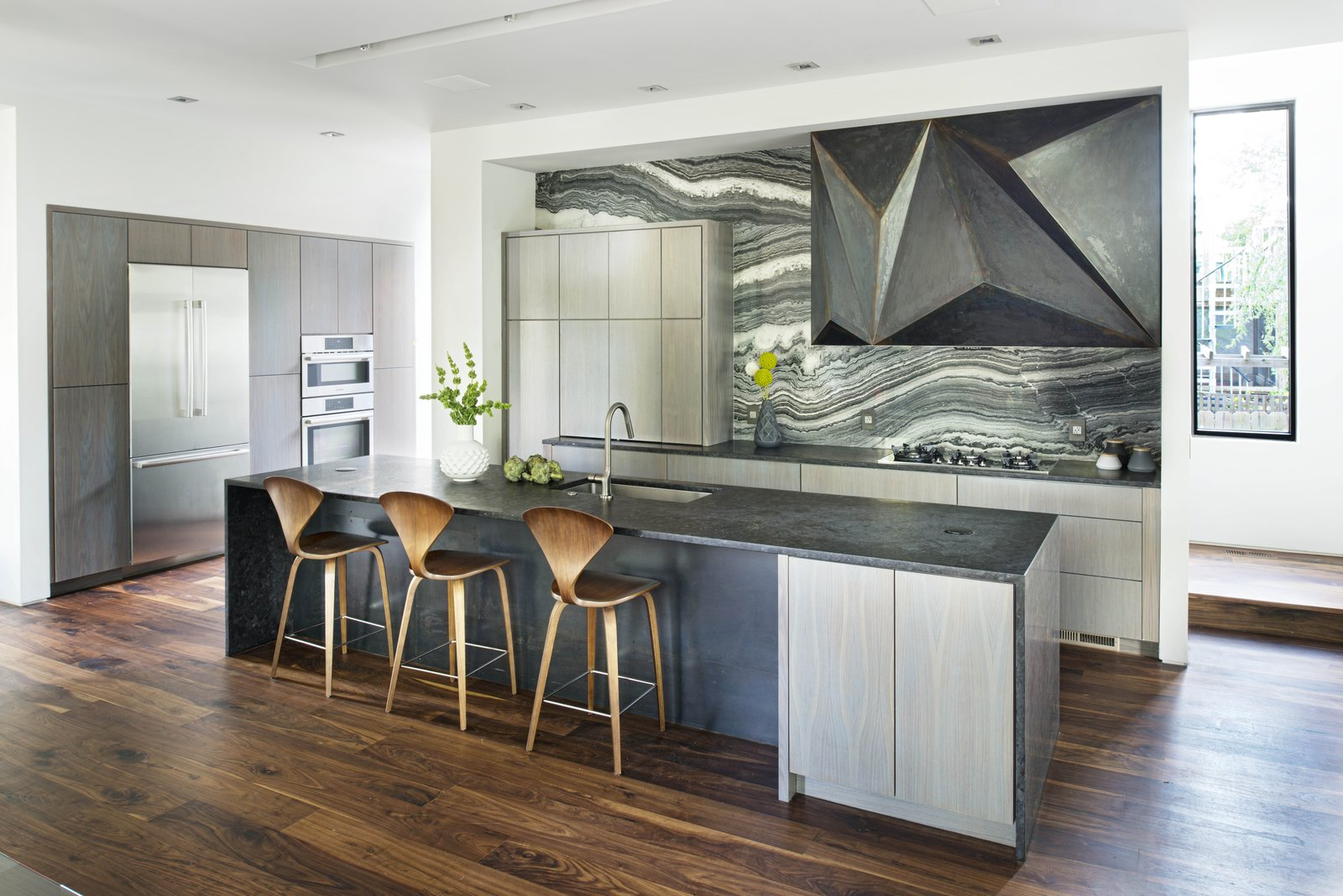 Custom steel vent hood designed by West Architecture Studio and fabricated by Luke Prestridge. Tagged: Kitchen, Recessed Lighting, Wood Cabinet, Refrigerator, Wall Oven, Undermount Sink, Marble Backsplashe, and Range. Alaska House by West Architecture Studio