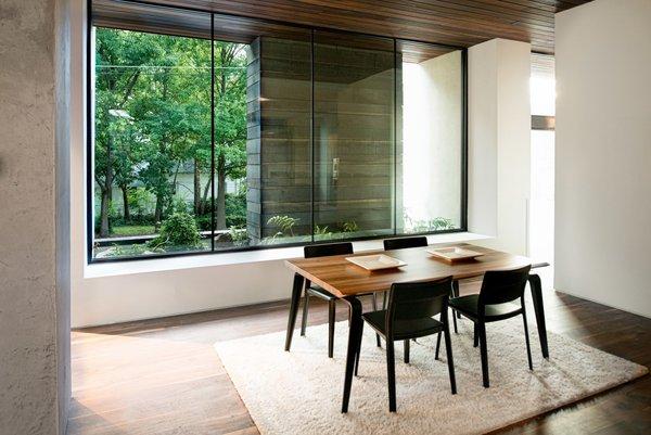 Modern home with dining room, medium hardwood floor, table, and chair. Photo 7 of Alaska House
