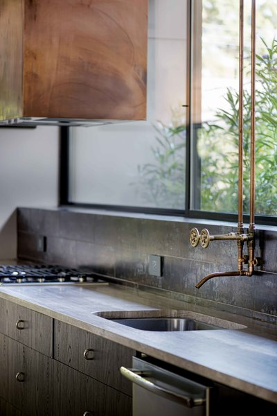 Custom copper vent hood and kitchen faucet Photo 7 of Pyrite House modern home
