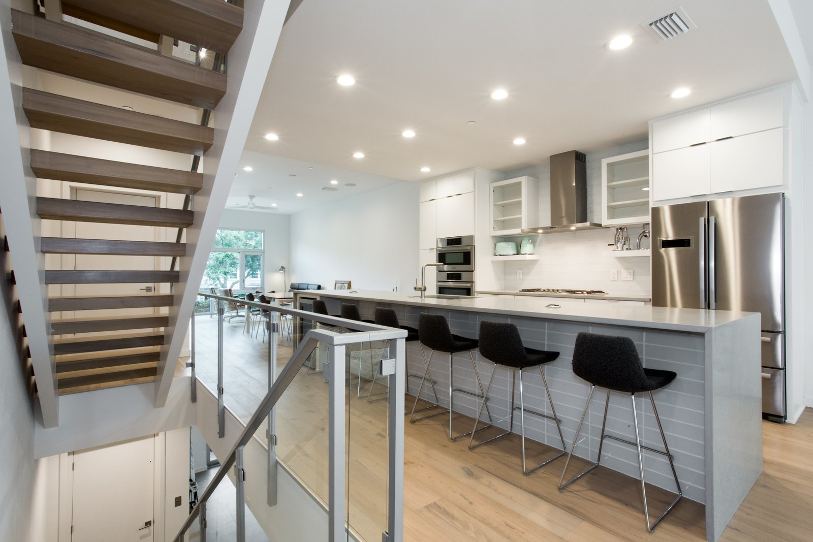 Kitchen and floating stairs.   LIV233 by Hudson Harr