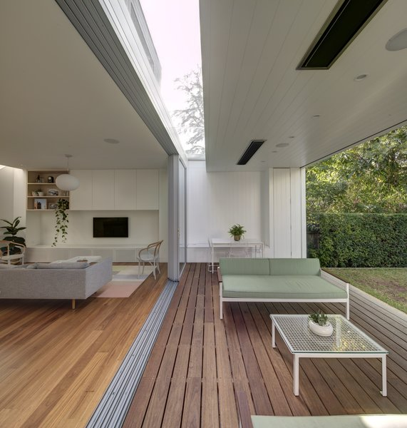 A second skylight cuts across the garden room, bringing soft natural light into the interior and providing balanced light to both sides of the garden room. Photo 9 of Inner West House modern home