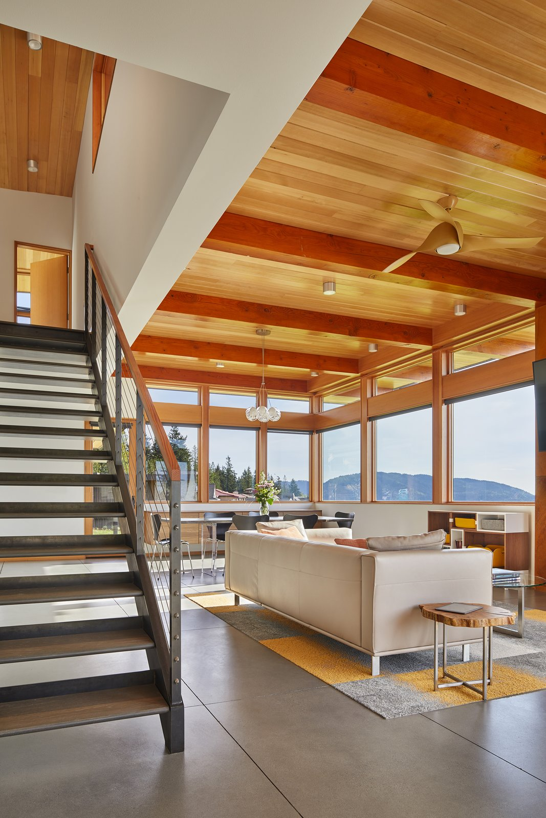 Tagged: Living Room, Concrete Floor, Sofa, and Ceiling Lighting.  Issaquah Highlands Residence by Studio Zerbey Architecture
