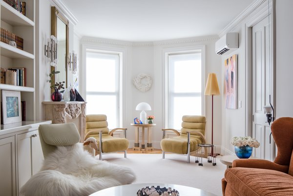 Modern home with wall lighting, swing door type, medium hardwood floor, standard layout fireplace, interior, end tables, and living room. Photo 2 of Greenpoint Townhouse