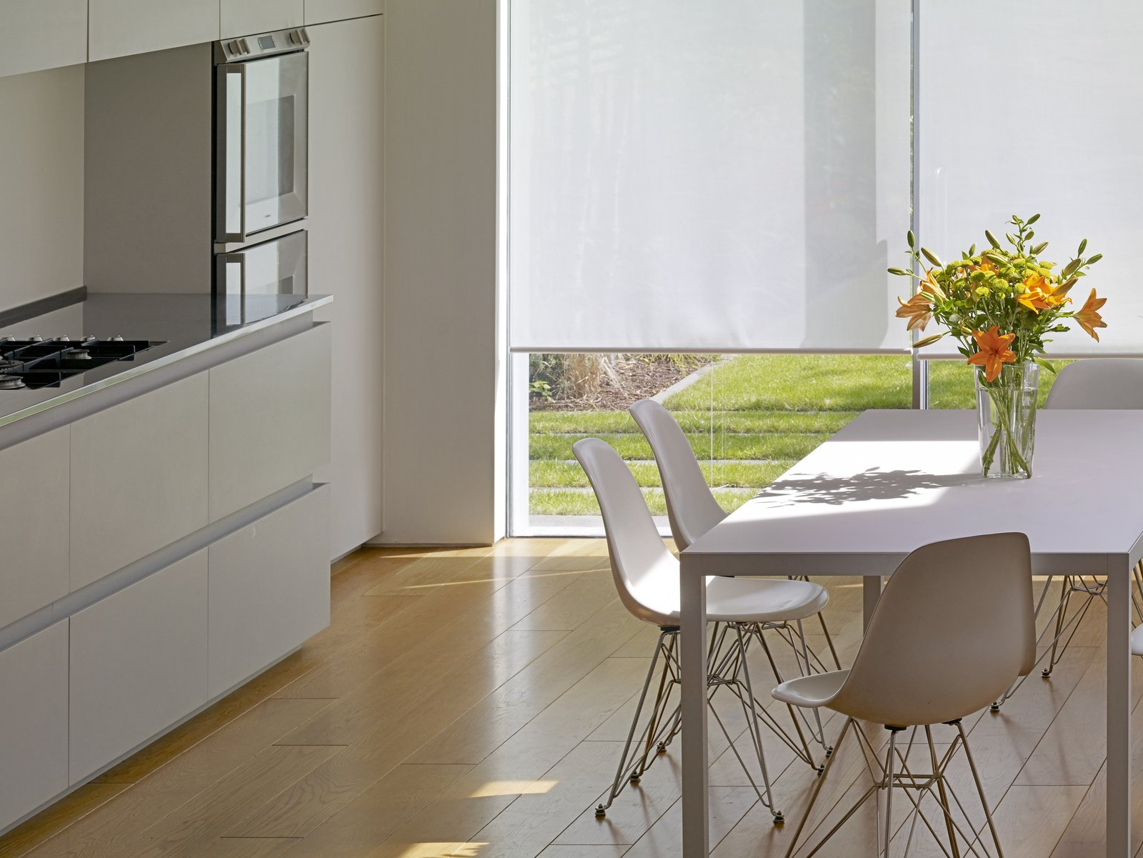 Tagged: Light Hardwood Floor, White Cabinet, Dining Room, Table, and Chair.  Elm Grove by Thompson + Baroni