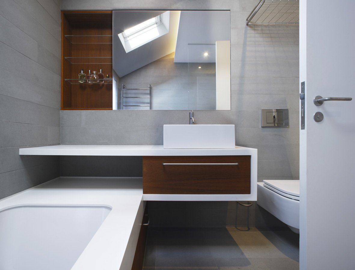 Tagged: Bath Room, Undermount Tub, Concrete Floor, Quartzite Counter, Vessel Sink, and One Piece Toilet.  Elm Grove by Thompson + Baroni