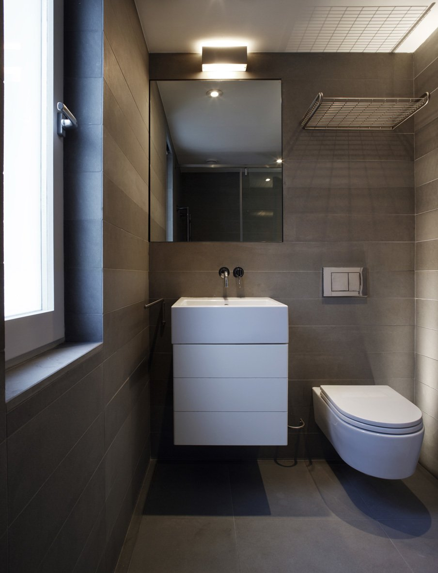Tagged: Bath Room, Concrete Floor, Vessel Sink, Ceiling Lighting, Stone Tile Wall, and One Piece Toilet.  Elm Grove by Thompson + Baroni