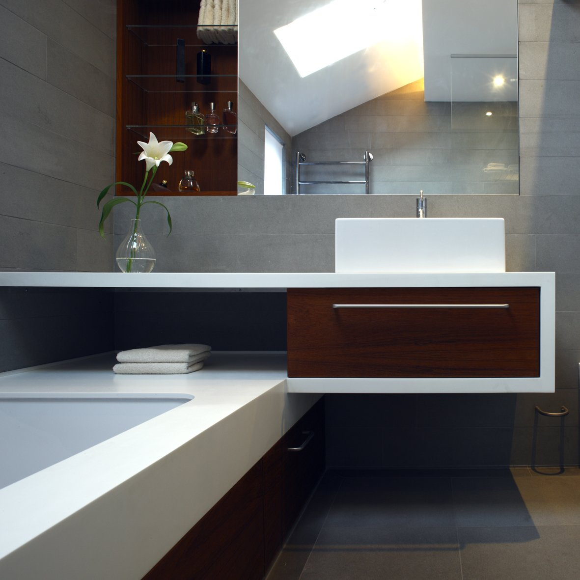 Tagged: Bath Room, Vessel Sink, Quartzite Counter, Concrete Floor, and Undermount Tub.  Elm Grove by Thompson + Baroni