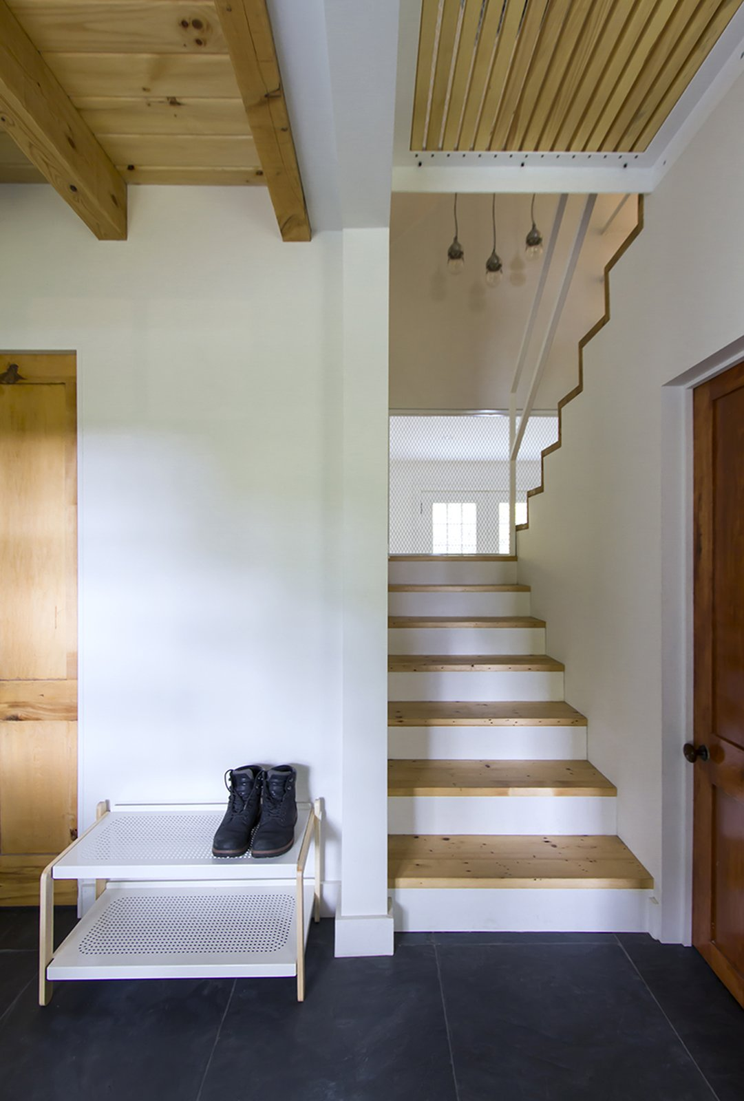 The staircase connects the ground floor corridor to the second floor. The small walkway separates the master privates appartement from the rest of the house. Tagged: Staircase, Metal Tread, Wood Tread, and Metal Railing.  L'Eau Vive by FÉLIX & Co.