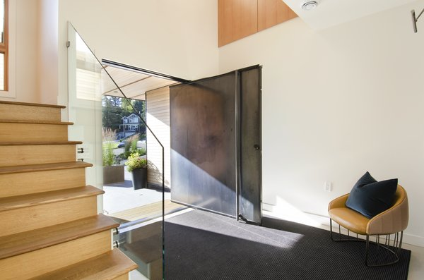 Steel pivot entry door Photo 6 of Hawthorne Residence modern home