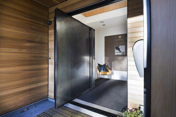 Steel pivot entry door Photo 10 of Hawthorne Residence modern home