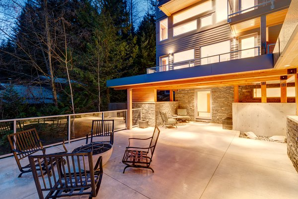 Modern home with outdoor, large patio, porch, deck, trees, hardscapes, concrete patio, porch, deck, stone patio, porch, deck, front yard, and rooftop. Front Patio Photo 10 of Whistler Residence