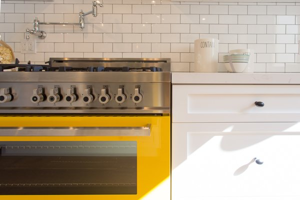 Love that bright yellow enamel stove, with stock pot water faucet Photo 3 of Modern Farmhouse modern home