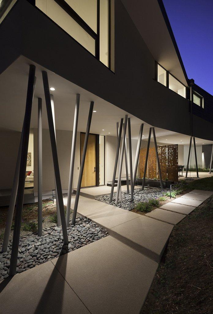 A splay of columns support the second floor 6th Street residence by Sarah Goldblatt
