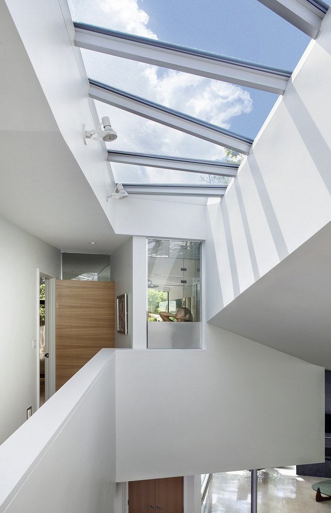 skylights flood the home with light and capture its unique geometry  6th Street residence by Sarah Goldblatt