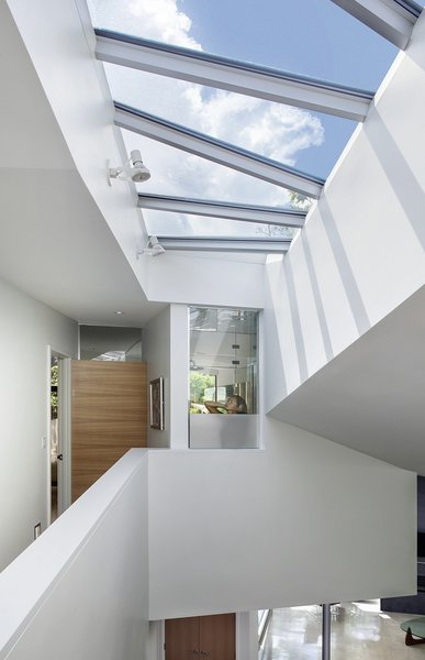 skylights flood the home with light and capture its unique geometry Photo 5 of 6th Street residence modern home