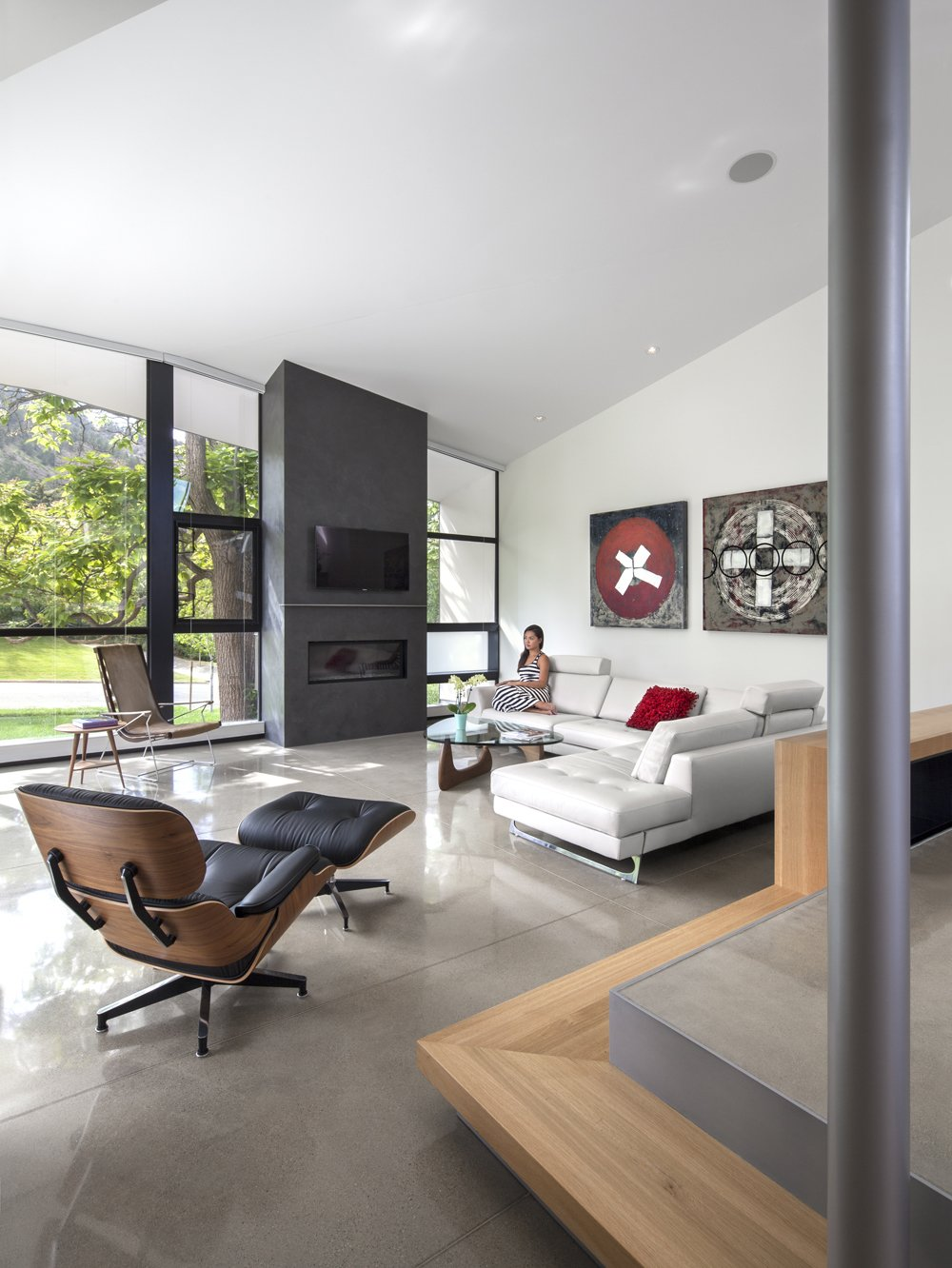 The living room features an Eames lounge chair and ottoman from Design Within Reach and original artwork by Bill Snider