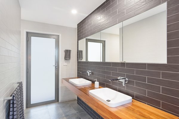 Ensuite Bathroom to Master Bedroom with access to rear for beach access Photo 3 of The Tathra Residence modern home