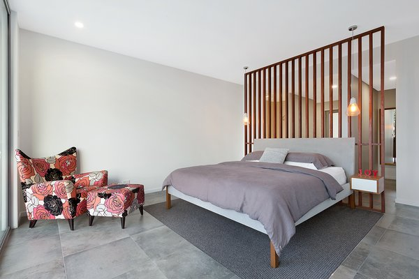 Master Bedroom with Ensuite and Walk-In-Robe behind ironbark timber screen. Photo 4 of The Tathra Residence modern home