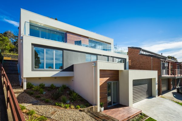 Front Elevation of Modernist Inspired three level home, sloping up a very steep block, with amazing ocean views to the front and connecting to the bush at the rear! Photo 8 of The Tathra Residence modern home