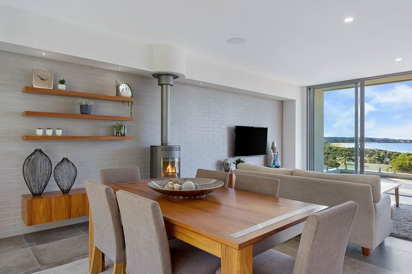 Feature Tiled Wall with Fire Place & Timber Joinery Photo 9 of The Tathra Residence modern home