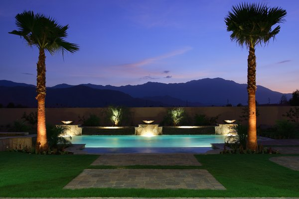 Sunset view of pool and San Jacinto mountain range Photo 2 of Whispering Wind modern home