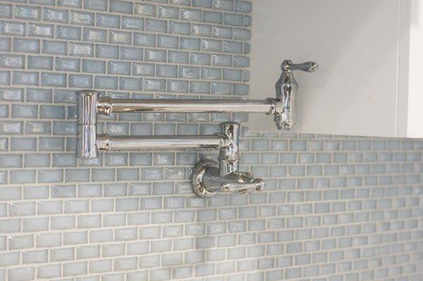 Photo 11 of South Carolina Residence: Milk Glass Backsplash modern home