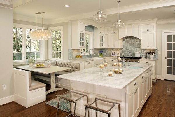 Modern home with kitchen, granite counter, white cabinet, medium hardwood floor, glass tile backsplashe, pendant lighting, drop in sink, and undermount sink. Photo 7 of House Of Turquoise