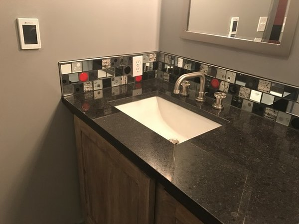 Modern home with bath room, glass tile wall, granite counter, and undermount sink. Photo  of Red Dot Bathroom Accent