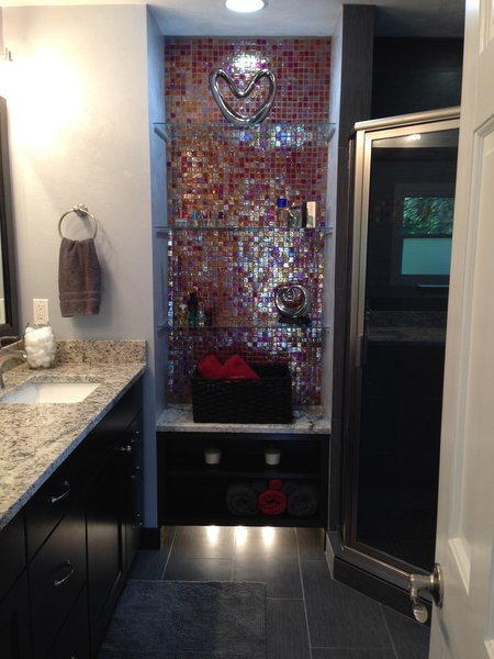 Modern home with bath room, granite counter, undermount sink, and corner shower. Photo  of Red Iridescent Glass Tile Bathroom Accent Wall