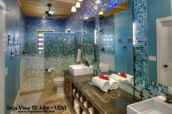 Modern home with bath room, vessel sink, granite counter, open shower, pendant lighting, one piece toilet, accent lighting, wall lighting, and glass tile wall. Photo  of Caribbean Beach Gradient Glass Tile Bathroom Design