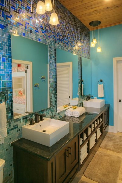 Modern home with bath room, granite counter, pendant lighting, vessel sink, open shower, wall lighting, one piece toilet, and glass tile wall. Photo 2 of Caribbean Beach Gradient Glass Tile Bathroom Design