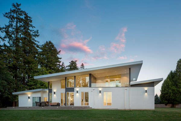 View side of the Lake House with multiple outdoor living choices. Photo  of The Lake House modern home