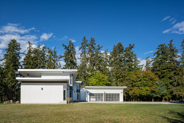 Roof composition and forest background Photo 2 of The Lake House modern home