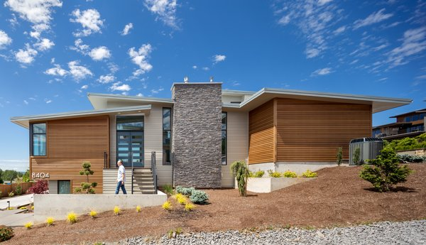 The forms step up the hill with the slope Photo 2 of Evergreen Pointe House modern home