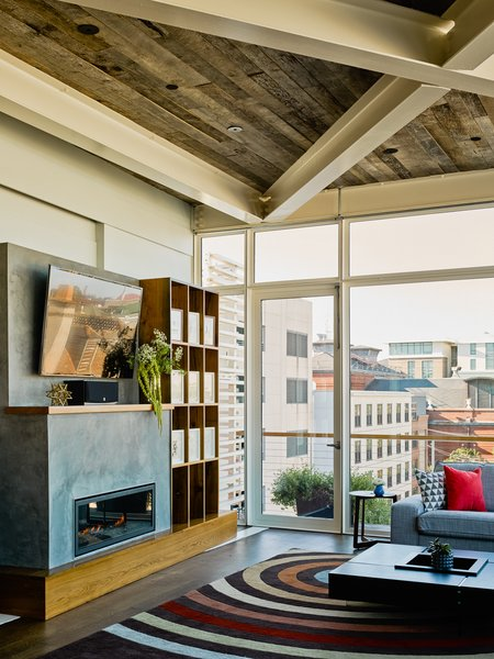 Modern home with living room, coffee tables, sofa, dark hardwood floor, and gas burning fireplace. Photo 15 of SKY residence