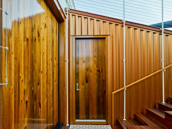 Modern home with doors, exterior, wood, sliding door type, and swing door type. Photo 8 of SKY residence