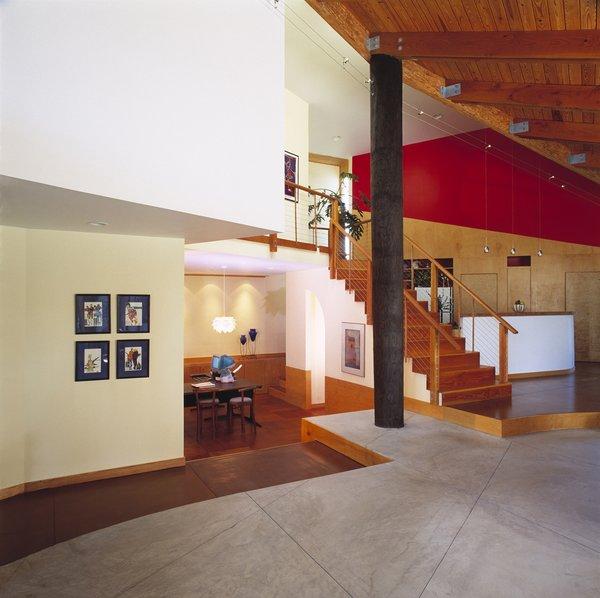 Modern home with living room, pendant lighting, concrete floor, ceiling lighting, and medium hardwood floor. Photo 2 of Island Residence