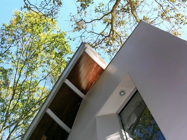 Exterior detail stair tower with metal ribs and hardwood cladding Photo 4 of The HR Home modern home
