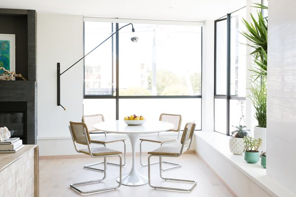 Dining room featuring Saarinen table and RH chairs. Photo 3 of Laurel Heights Residence modern home