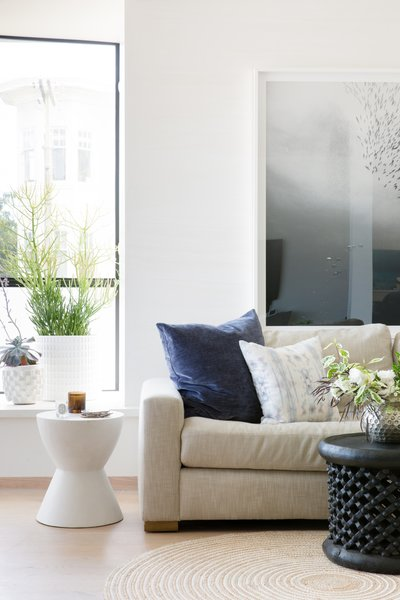 Living room featuring Eskayel textiles and St. Frank coffee table. Photo 2 of Laurel Heights Residence modern home