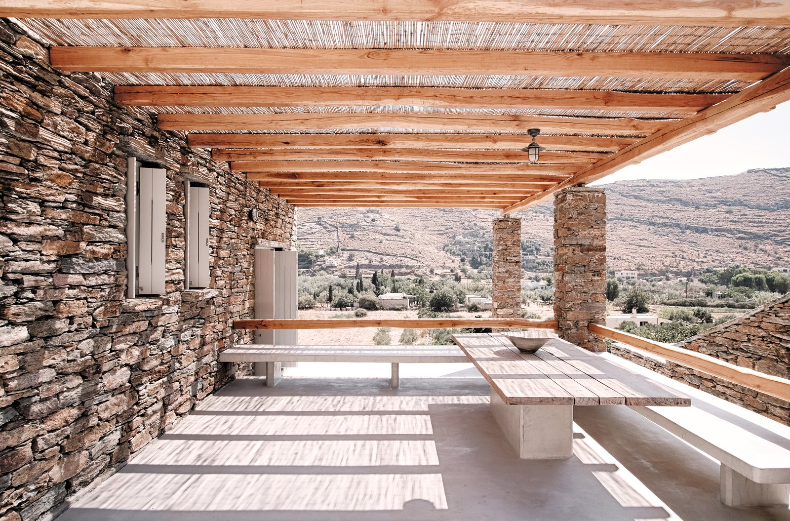 Exterior eating area with views towards the valley Tagged: Outdoor, Back Yard, Desert, Small Patio, Porch, Deck, and Wood Patio, Porch, Deck.  ROCKSPLIT house by COMETA ARCHITECTS